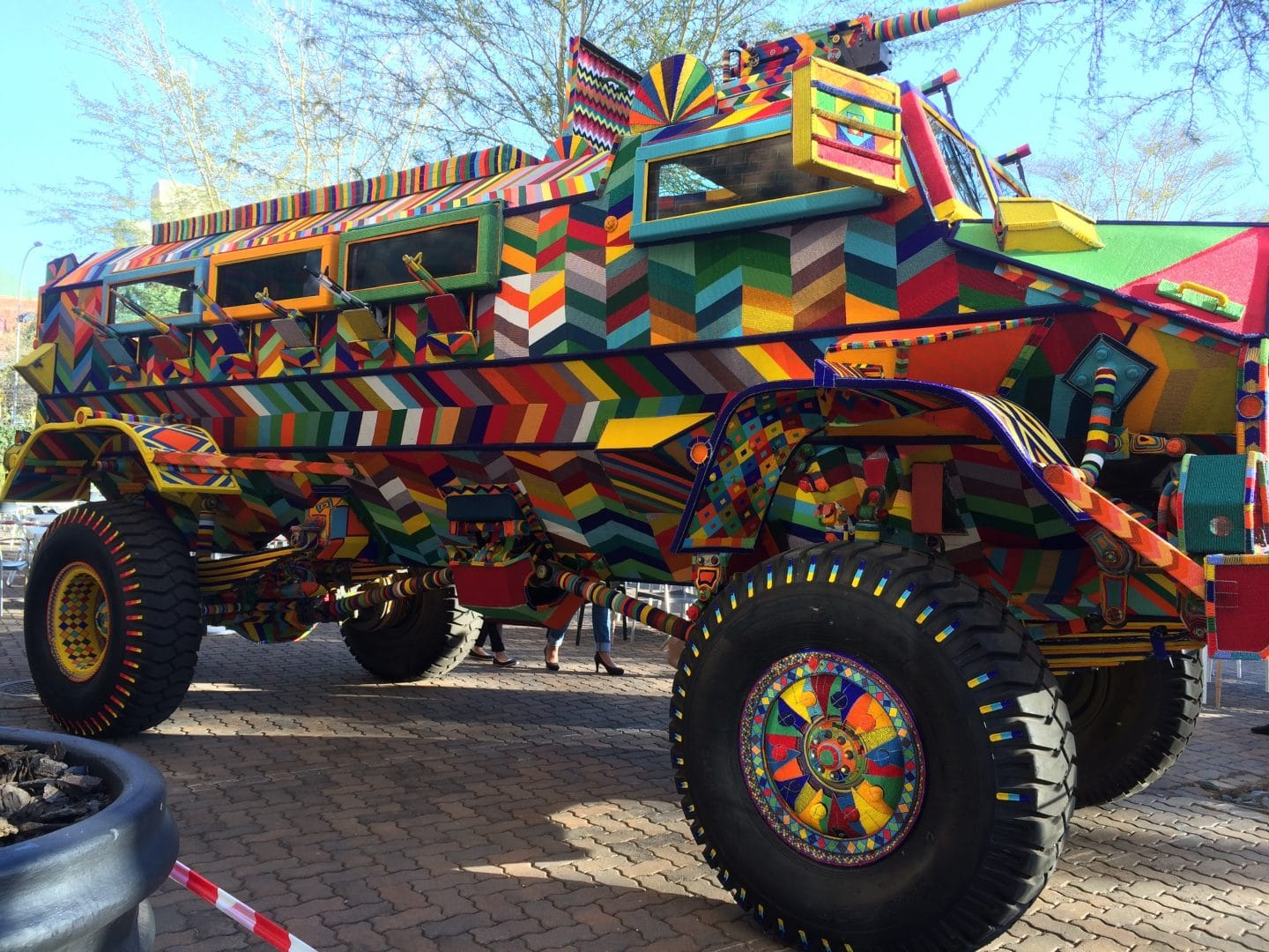 A Technicolor Armored Vehicle Arrives In A San Francisco Parking Lot